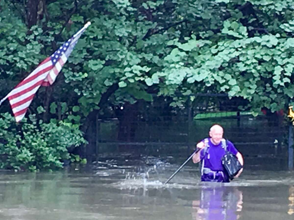Former Houston Mayor Bill White leaves his flooded house off Buffalo Bayou during Hurricane Harvey in this photo taken by a neighbor.
