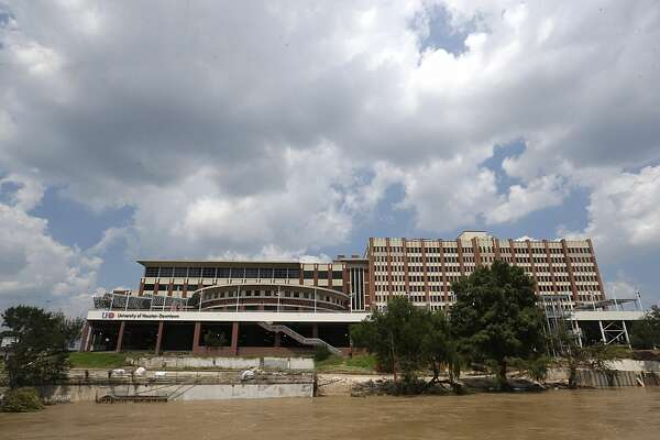 A swollen Buffalo Bayou rushes past the University of Houston Downtown main building complex after Hurricane Harvey damaged it with 33 inches of water on the first floor, inflicting an estimated $8 million in damages. It sits in the middle of a floodway.
