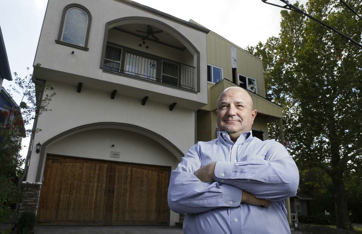 Bruce Norcini poses in Houston near town homes that now stand on land along W. 21st Street that he once owned. In 2006, the city prohibited building in floodways. Overnight, it rendered Norcini's property on W. 21st Street worthless. Norcini and others sued and forced the city to rewrite the ordinance.