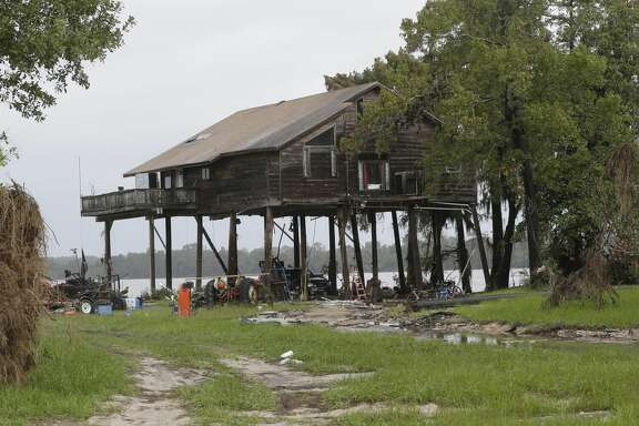 A home is shown along Grace Lane in the Banana Bend area, in Highlands.  Some sections of the roadway were washed away during flooding from the San Jacinto River during Hurricane Harvey.