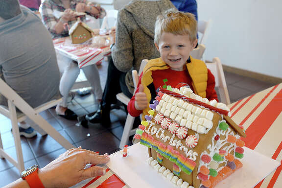 Lane Henderson reacts as he takes in the final product of his creation while taking part in the Art Museum of Southeast Texas' annual gingerbread house decorating event Saturday. Photo taken Saturday, December 2, 2017 Kim Brent/The Enterprise
