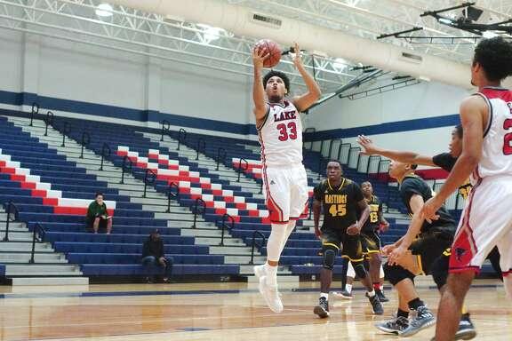 Clear Lake's Jeremiah Maldonado (33) lays up a shot against Hastings during the Carlisle-Krueger Classic basketball tournament at Clear Lake High School.