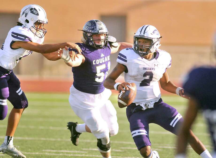 Port Neches-Groves quarterback Roschon Johnson, right, scrambles as the College Station defense closes in during a fourth quarter drive Saturday at Turner Stadium in Humble. (Mike Tobias/The Enterprise) Photo: Mike Tobias/The Enterprise