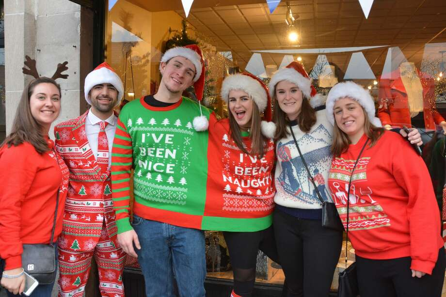 The conjoined twins sweater and the sleek holiday business suitSantas