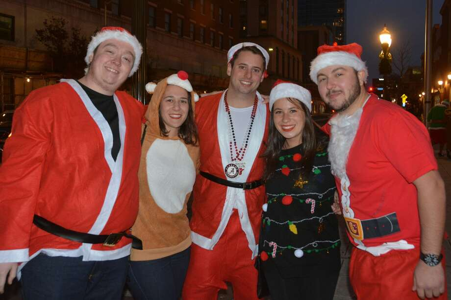 Santas swarmed the streets of Stamford during the annual SantaCon bar crawl on December 2, 2017. Revelers dressed in holiday garb took advantage of drink specials at participating bars. Were you SEEN? Photo: Vic Eng / Hearst Connecticut Media Group