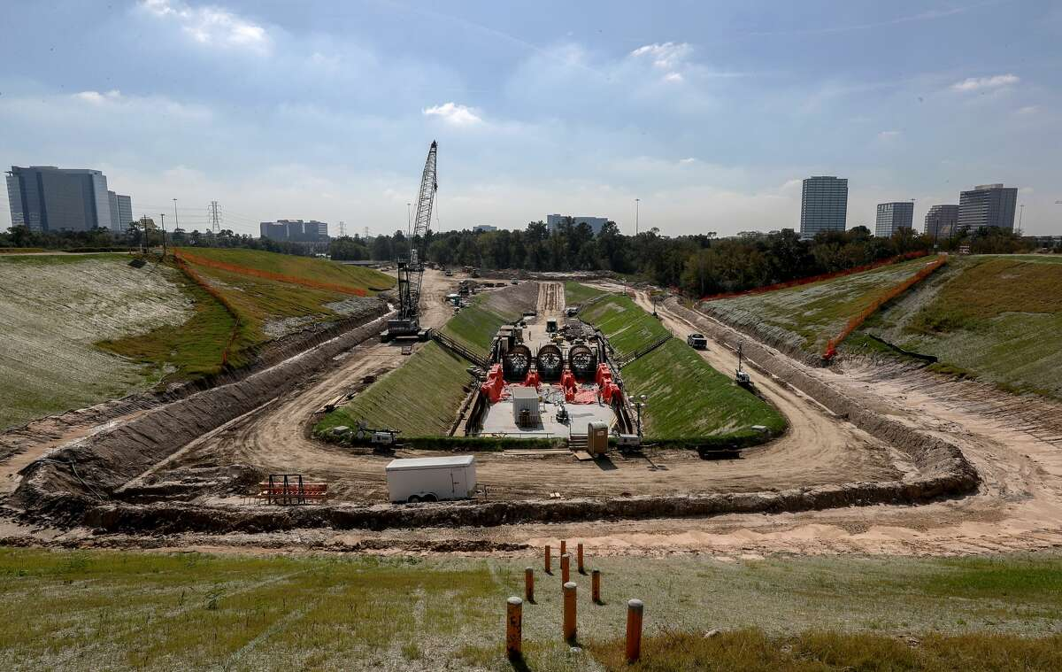 A water control structure is under construction at the Addicks Reservoir, in Houston.