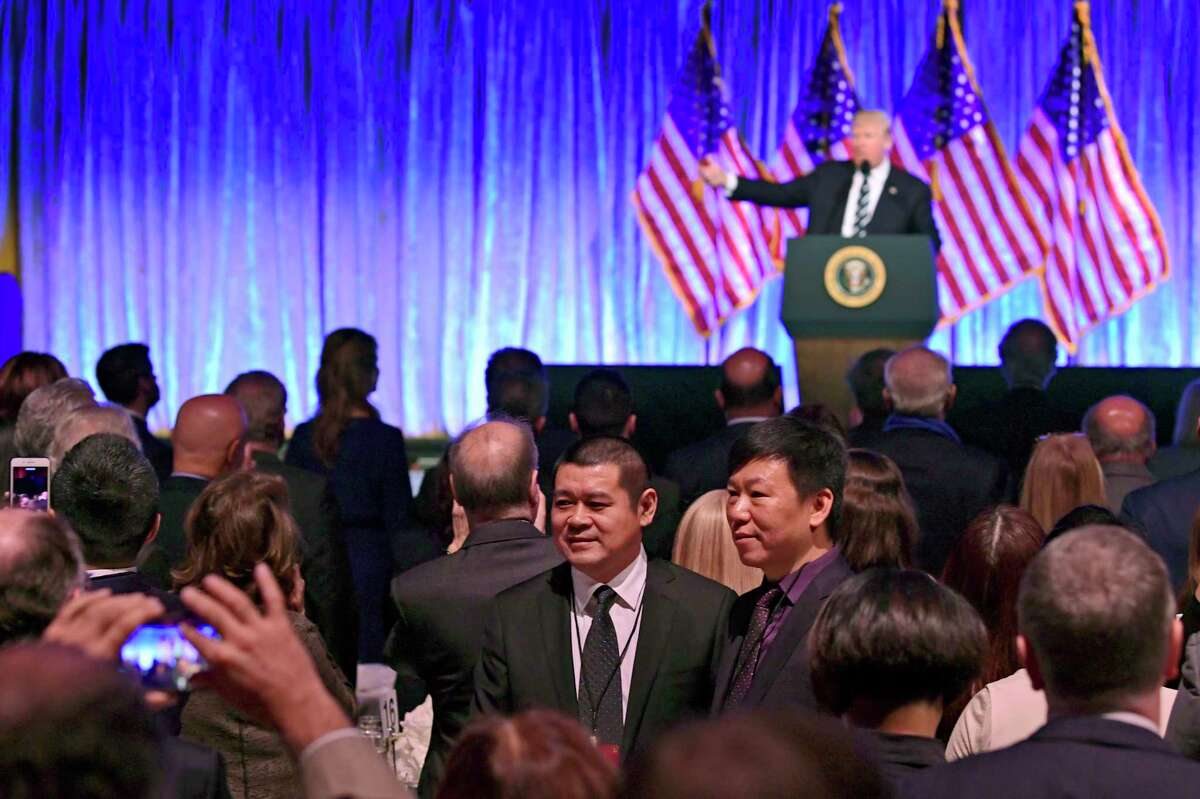People in the audience have their photo taken as President Donald Trump speaks at a fundraiser at Cipriani in New York, Saturday, Dec. 2, 2017. Trump is attending a trio of fundraisers during his day in New York. (AP Photo/Susan Walsh) ORG XMIT: NYSW109