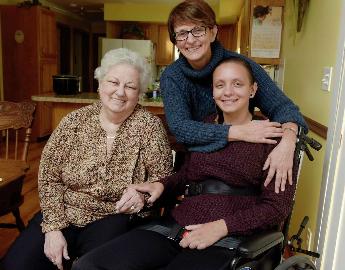 Jeanne Warzek, left, poses for a photo with her daughter, Susan Warzek, center, and her granddaughter and Susan's daughter, Morgan Waite on Wednesday, Nov. 15, 2017, in Halfmoon, N.Y. (Paul Buckowski / Times Union)