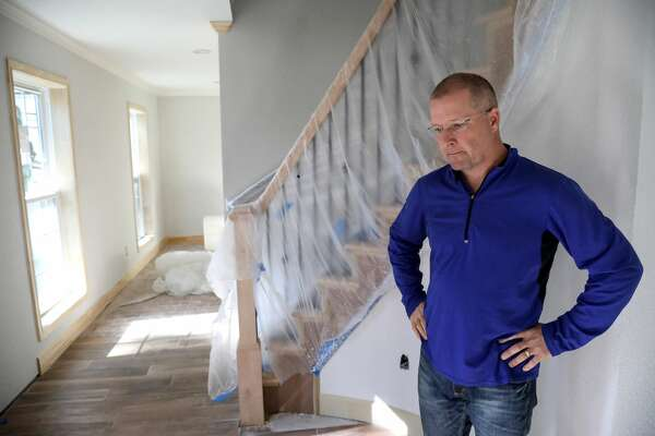 Todd Middleton pauses while talking about the damage to his Norchester-area home, caused by Hurricane Harvey, in Houston.