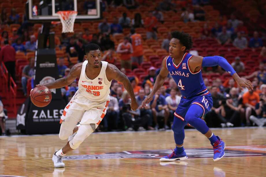 MIAMI, FL - DECEMBER 02: Frank Howard #23 of the Syracuse Orange drives against Devonte' Graham #4 of the Kansas Jayhawks during the HoopHall Miami Invitational at American Airlines Arena on December 2, 2017 in Miami, Florida.  (Photo by Chris Trotman/Getty Images) ORG XMIT: 775076727 Photo: Chris Trotman / 2017 Getty Images