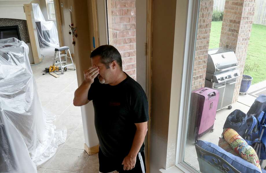 "Scott Dorman, who moved from Connecticut with his wife, rubs his face as he talks about damage from Hurricane Harvey, in Riverstone. Dorman's house backs up to a levee. ""When I moved here, people said at least you don't have to shovel snow,"" Dorman said. ""But, you can't shovel water."" Photo: Jon Shapley/Houston Chronicle"