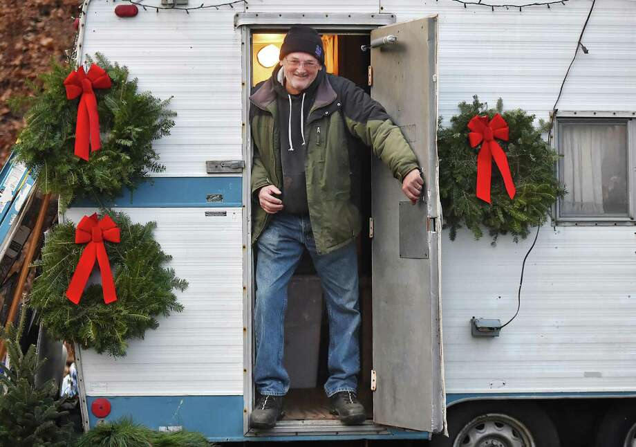 Doug DuPaul works at D & B Christmas Tree in Hamden, Saturday, Dec. 2, 2017, during the annual Silverbells Holiday Festival, an annual outdoor celebration sponsored by the Hamden Arts Commission and the Department of Arts & Culture at Town Center Park in Hamden. Photo: Catherine Avalone, Hearst Connecticut Media / New Haven Register