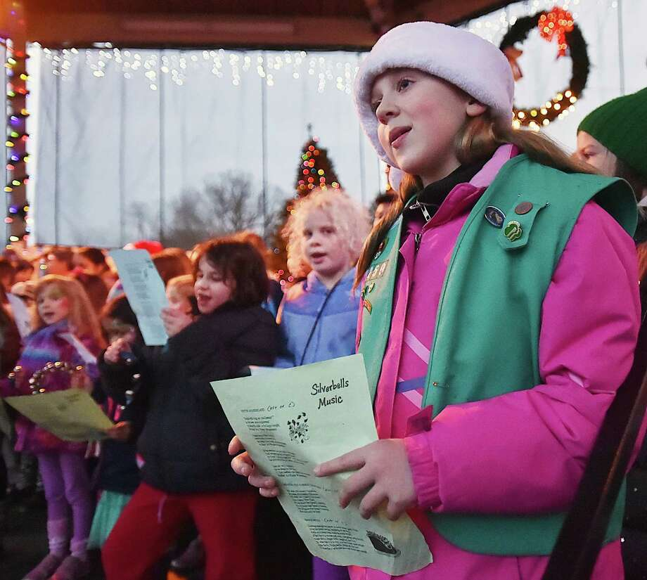 Hamden school children sing Christmas carols at the Hamden annual Silverbells Holiday Festival, Saturday, Dec. 2, 2017, an annual outdoor celebration sponsored by the Hamden Arts Commission and the Department of Arts & Culture at the gazebo at Town Center Park in Hamden. Photo: Catherine Avalone, Hearst Connecticut Media / New Haven Register