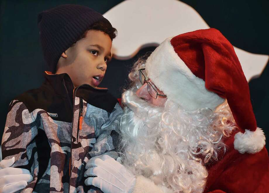 Ari Kilkenny,7, discusses top items on his Christmas list with Santa at the Hamden annual Silverbells Holiday Festival, Saturday, Dec. 2, 2017, an annual outdoor celebration sponsored by the Hamden Arts Commission and the Department of Arts & Culture at Town Center Park in Hamden. Photo: Catherine Avalone, Hearst Connecticut Media / New Haven Register