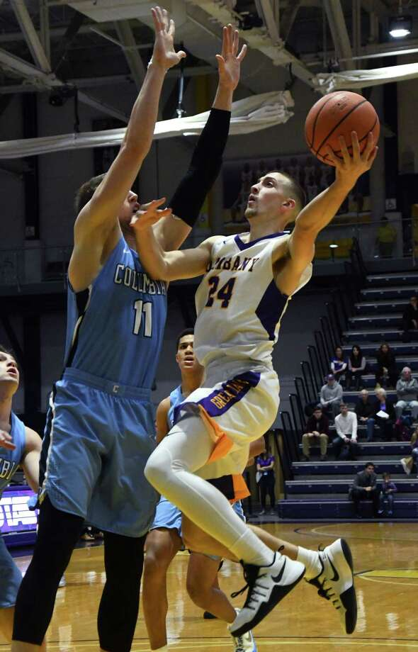 Albany guard Joe Cremo jumps for a shot as Columbia forward Lukas Meisner during a game against Columbia on Saturday in Albany. (Jenn March/Special to the Times Union) Photo: Jenn March / 20042278A