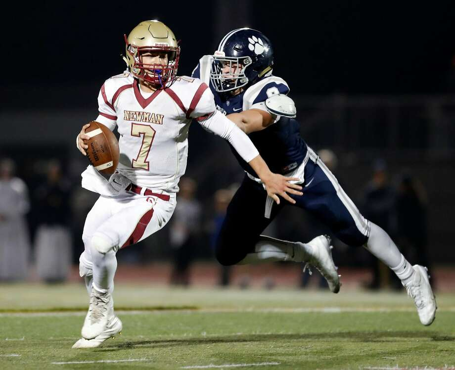 Cardinal Newman quarterback Beau Barrington (7) eludes Marin Catholic's Jack Wirth for a first down in the North Coast Section Division 3 football championship game in Rohnert Park. Photo: Scott Strazzante, The Chronicle