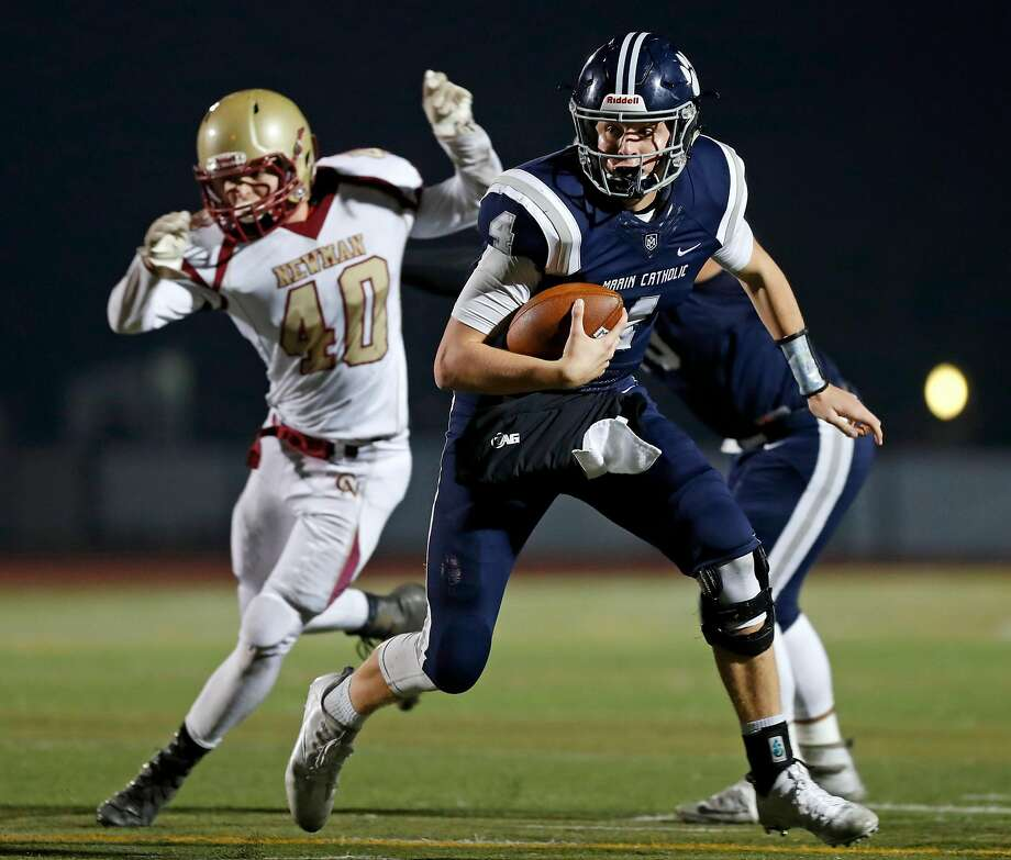 Marin Catholic's Spencer Petras rushes in 4th quarter of Marin's 59-56 win over Cardinal Newman in North Coast Section Division 3 football championship game in Rohnert Park, Calif., on Saturday, December 2, 2017. Photo: Scott Strazzante, The Chronicle