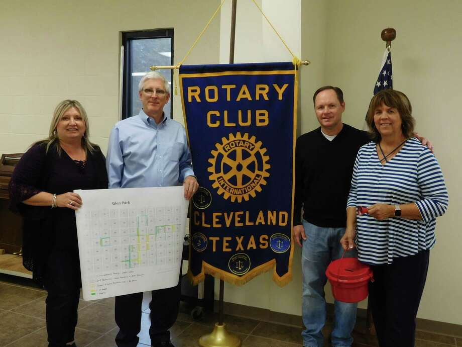 Fran Born and Ken Wickens of Kendall Homes (holding a plat of the Glen Park area); Rotary President Scott Lambert; and Pastor Frieda White with the Salvation Army Red Kettle are pictured at the Nov. 29 Rotary Club luncheon. Photo: Submitted