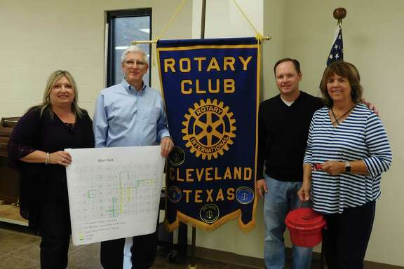 Fran Born and Ken Wickens of Kendall Homes (holding a plat of the Glen Park area); Rotary President Scott Lambert; and Pastor Frieda White with the Salvation Army Red Kettle are pictured at the Nov. 29 Rotary Club luncheon.