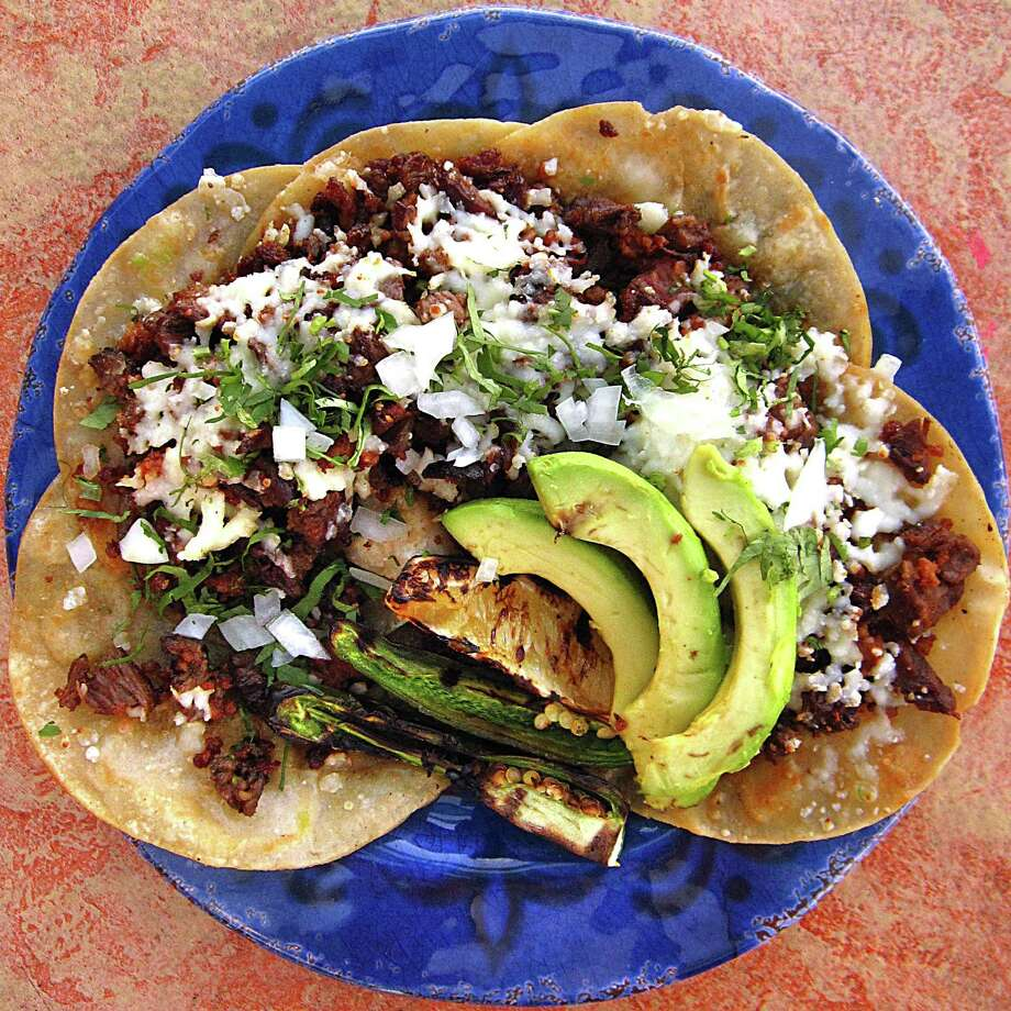 San Miguel Tacos with carne asada, chorizo and queso blanco on corn tortillas from Aldaco's Mexican Cuisine. Photo: Mike Sutter /San Antonio Express-News
