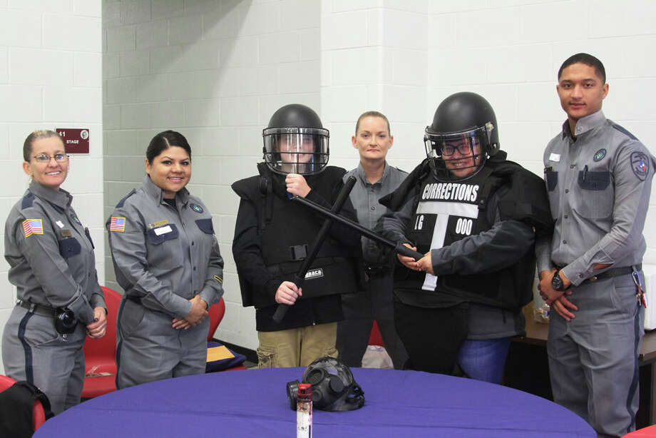Officers for the Texas Department of Criminal Justice were great sports at the Lincoln Junior High Career Fair on Friday, Dec. 1. Their riot gear was a big hit with students. Pictured from left to right are Officer Shari Kendry, Lieutenant Yesenia Beltran, LJH eighth-grader Elijah Horton, Officer Susie Brewer, LJH eighth-grader Sahriya Clark and Sergeant Adrian Smith. Photo: Submitted