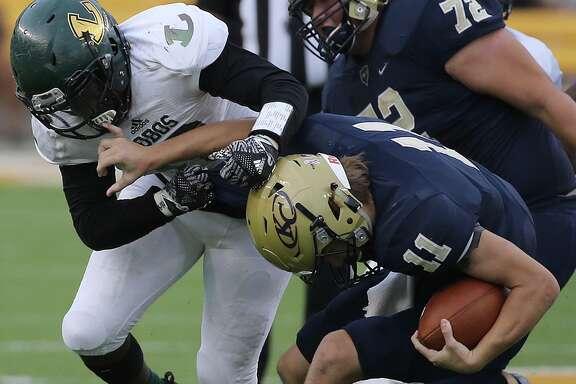 Longview's Ke' Andre Mauldin sacks Klein Collins' quarterback Rhyne Carter in the second half.