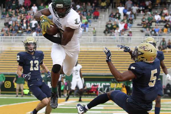 Longview's Jaylin Brown (86) catches a pass for a touchdown against Klein Collins' Phillip Hill (5) while Jeremy Owens (13) looks on in the first half Saturday December 2, 2017, in Waco.