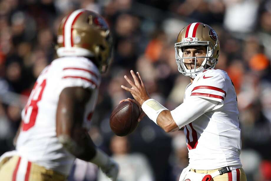 Quarterback Jimmy Garoppolo #10 of the San Francisco 49ers looks to pass the football in the first quarter against the Chicago Bears at Soldier Field on December 3, 2017 in Chicago, Illinois. Photo: Joe Robbins, Getty Images
