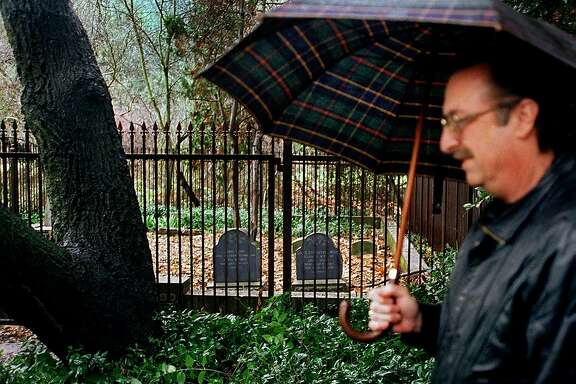 John Muir's great grandson David Hanna stands next to the gravesite of Muir and his family in 2001.