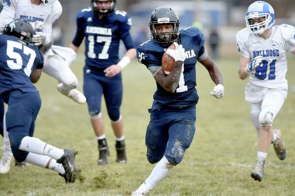 Markell Dobbs of Ansonia runs for a touchdown against Stafford/East Windsor/Somers in the second quarter of the Class S state football semifinal on December 3, 2017.