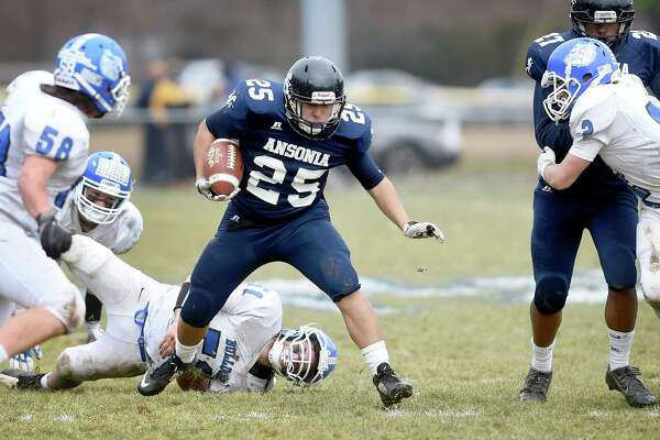 Darwin Amaya of Ansonia runs against Stafford/East Windsor/Somers in the second quarter of the Class S state football semifinal on December 3, 2017.