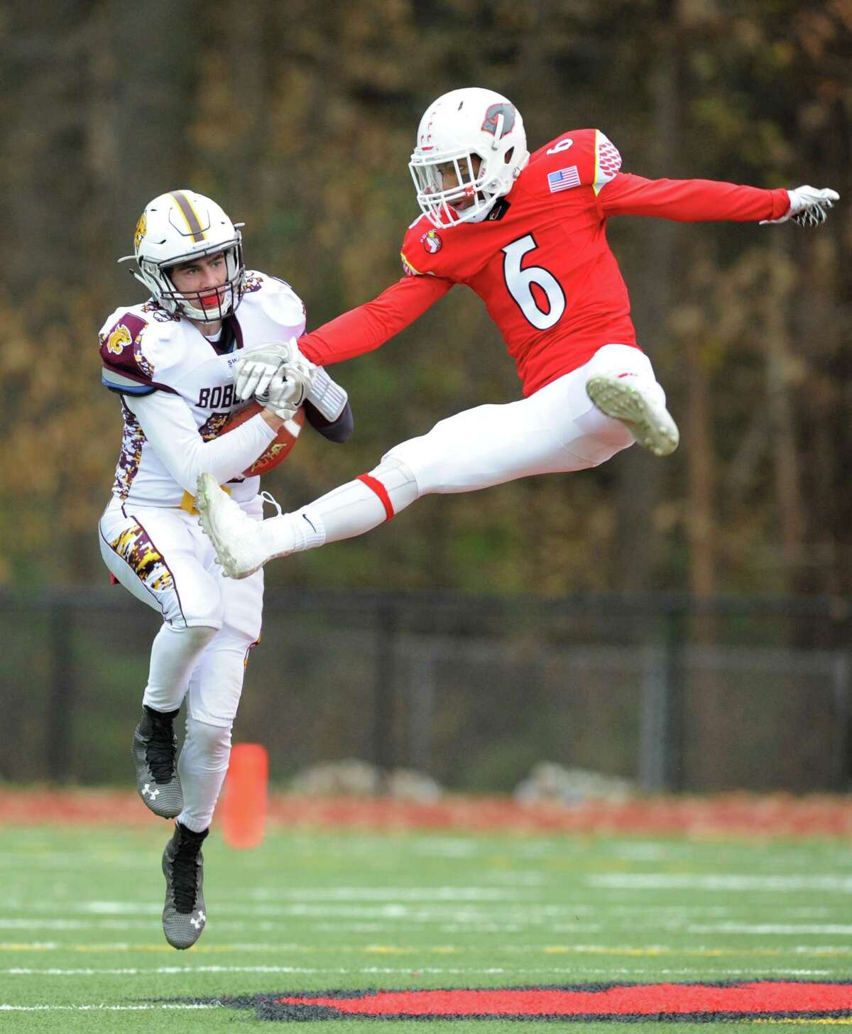 Greenwich cornerback Jeremiah Harris, right, gets airborne to break up a pass intended for South Windsor receiver Colin Ryan in No. 1 Greenwich's 36-7 win over No. 4 South Windsor in the high school football CIAC State Tournament Class LL semifinal game at Greenwich High School in Greenwich, Conn. Sunday, Dec. 3, 2017.