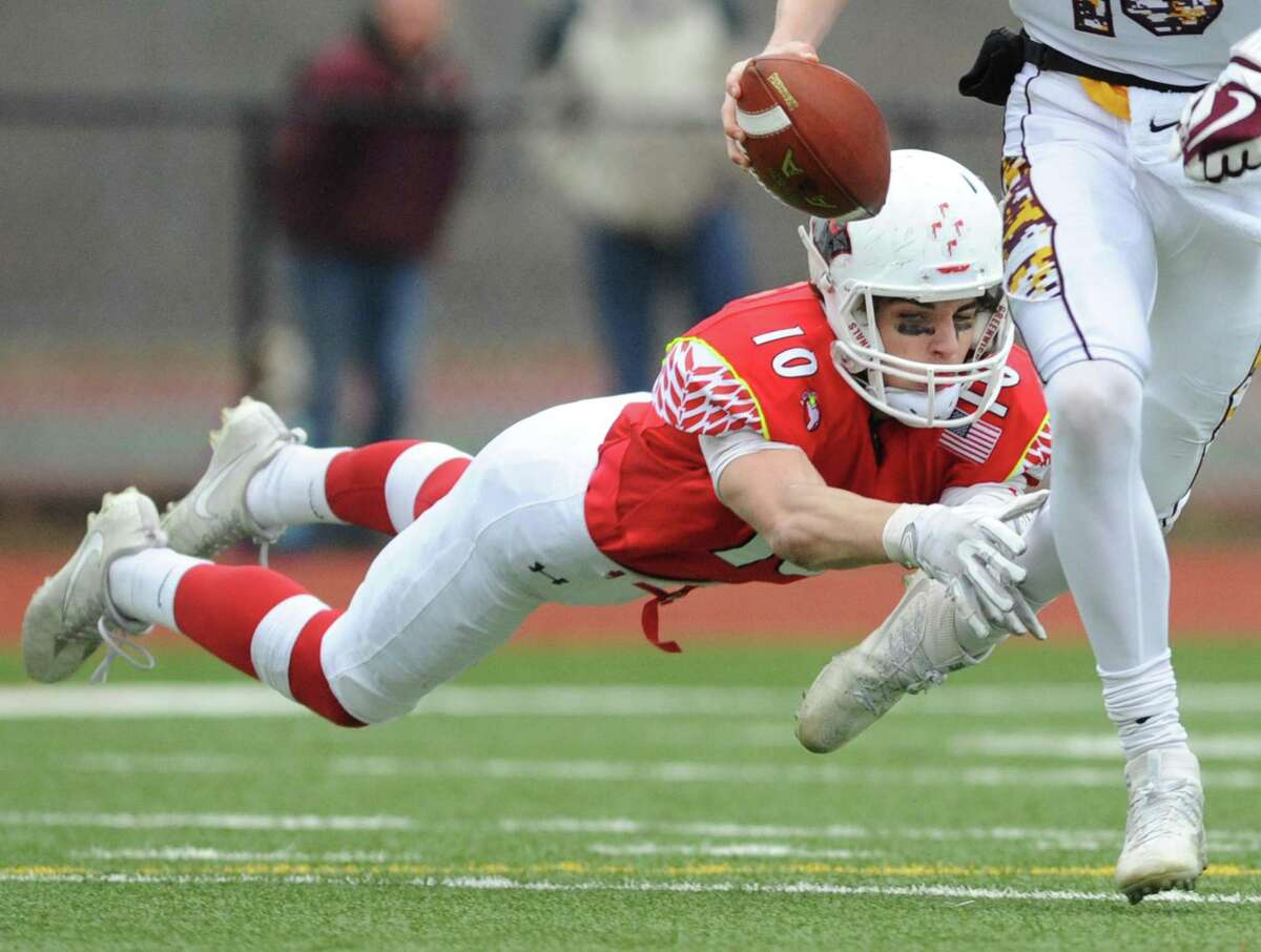 Greenwich defensive end Tyler Blizzard dives at the feet of South Windsor quarterback Connor Kapisak in No. 1 Greenwich's 36-7 win over No. 4 South Windsor in the high school football CIAC State Tournament Class LL semifinal game at Greenwich High School in Greenwich, Conn. Sunday, Dec. 3, 2017.