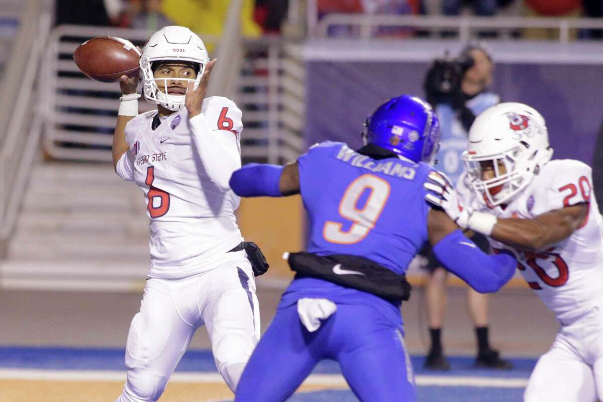 Fresno State quarterback Marcus McMaryion (6) passes under pressure from Boise State linebacker Desmond Williams (9) during the first half of an NCAA college football game for the Mountain West championship in Boise, Idaho, Saturday, Dec. 2, 2017. Boise State won 17-14. (AP Photo/Otto Kitsinger)