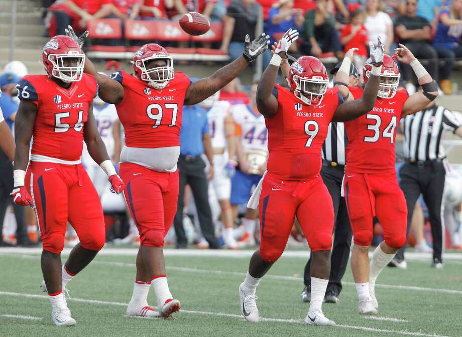Fresno State defenders from left to right, Tobenna Okeke, Malik Forrester, Jeffrey Allison and George Helmuth celebrate a defensive stop to seal a victory against Boise State during the second half of an NCAA college football game in Fresno, Calif., Saturday, Nov. 25, 2017. Fresno State won 28-17. (AP Photo/Gary Kazanjian) Photo: Gary Kazanjian, Associated Press / FR71556 AP
