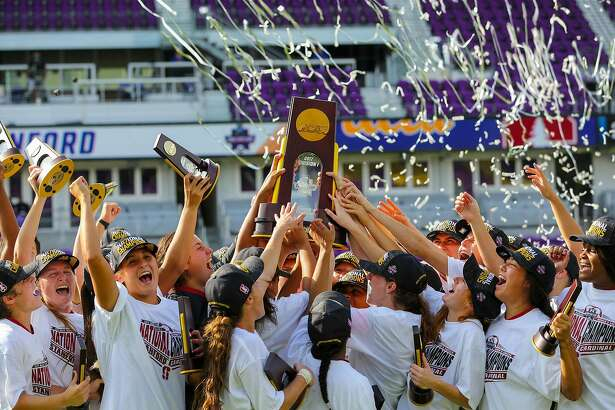 Members of the Stanford women's soccer team celebrate and hold the national championship trophy aloft after being UCLA 3-2 in the Women's College Cup final in Orlando on Sunday.