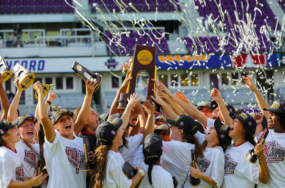 Members of the Stanford women's soccer team celebrate and hold the national championship trophy aloft after being UCLA 3-2 in the College Cup final in Orlando on Sunday. Photo: Stanford Photo