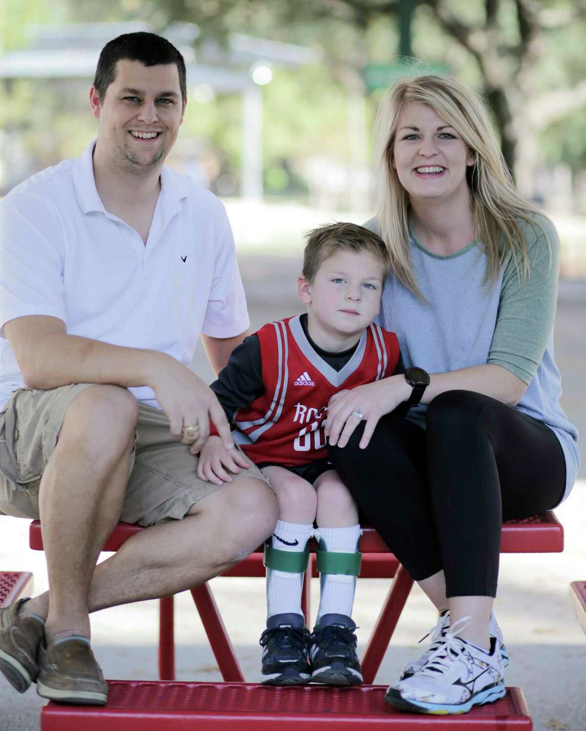 Jackson Raygor, 4, with his parents Joshua and Kyla on Saturday, Dec. 2, 2017, in Houston.