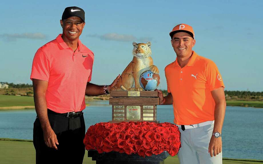 NASSAU, BAHAMAS - DECEMBER 03:  Rickie Fowler of the United States poses with tournament host Tiger Woods after winning the Hero World Challenge at Albany, Bahamas on December 3, 2017 in Nassau, Bahamas. Photo: Mike Ehrmann, Getty Images / 2017 Getty Images