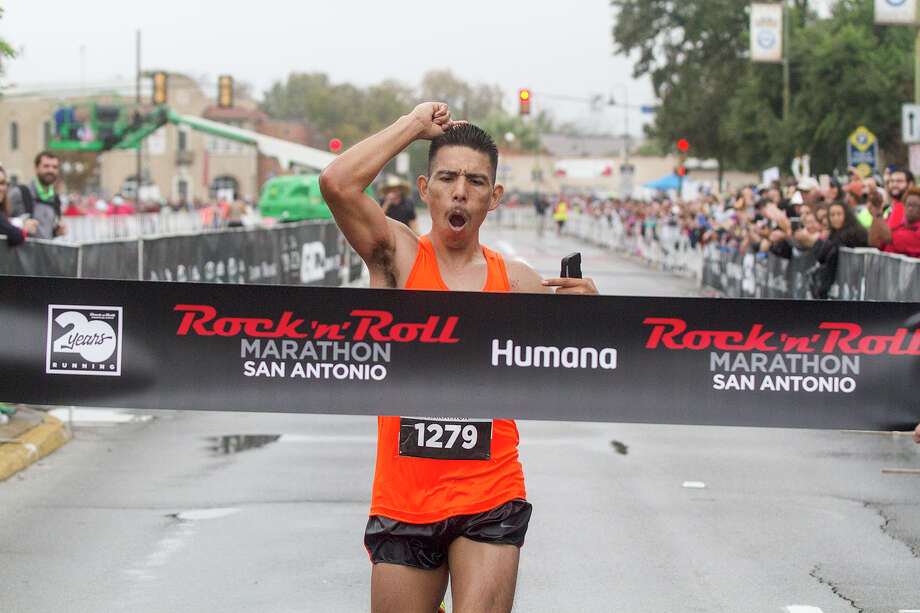 Erik Burciaga, of San Antonio, finished the Rock 'n' Roll Marathon in first place with a time of 2 hours and 42 minutes, Sunday, Dec. 3, 2107 in front of Hemisphere Park. Photo: Alma E. Hernandez, Alma E. Hernandez / For The San Antonio Express News