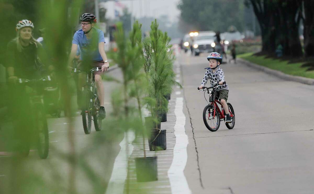 Trees divide a pop-up bike lane on Eldridge Parkway during the Cigna Sunday Streets on Sunday, Dec. 3, 2017, in Houston.