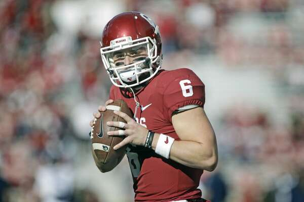 NORMAN, OK - NOVEMBER 25: Quarterback Baker Mayfield #6 of the Oklahoma Sooners warms up before the game against the West Virginia Mountaineers at Gaylord Family Oklahoma Memorial Stadium on November 25, 2017 in Norman, Oklahoma. Oklahoma defeated West Virginia 59-31. (Photo by Brett Deering/Getty Images)