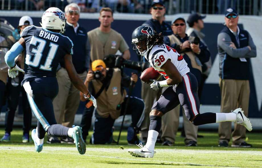 Houston Texans running back Andre Ellington (38) makes a first down reception against Tennessee Titans free safety Kevin Byard (31) during the first quarter of an NFL football game at Nissan Stadium on Sunday, Dec. 3, 2017, in Nashville. Photo: Brett Coomer, Houston Chronicle / © 2017 Houston Chronicle