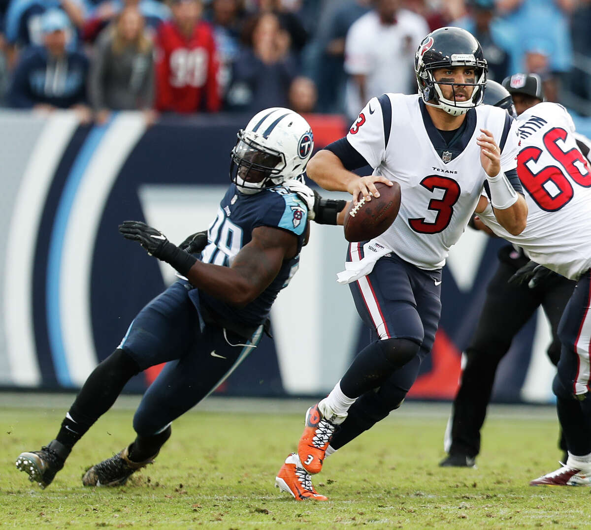 Houston Texans quarterback Tom Savage (3) is forced out of the pocket by Tennessee Titans outside linebacker Brian Orakpo (98) during the fourth quarter of an NFL football game at Nissan Stadium on Sunday, Dec. 3, 2017, in Nashville.