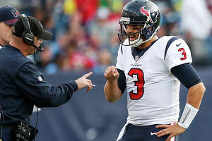 Houston Texans head coach Bill O'Brien talks to Houston  quarterback Tom Savage (3) during a time out in the fourth quarter of an NFL football game against the Tennessee Titans at Nissan Stadium on Sunday, Dec. 3, 2017, in Nashville.