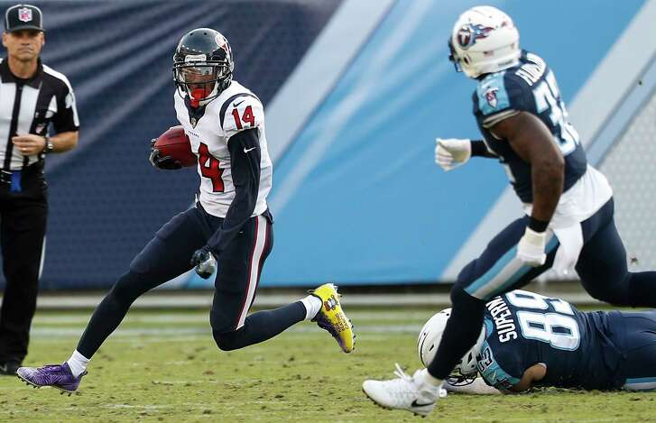 Houston Texans wide receiver Chris Thompson (14) runs past Tennessee Titans tight end Phillip Supernaw (89) as he returns a punt during the fourth quarter of an NFL football game at Nissan Stadium on Sunday, Dec. 3, 2017, in Nashville.