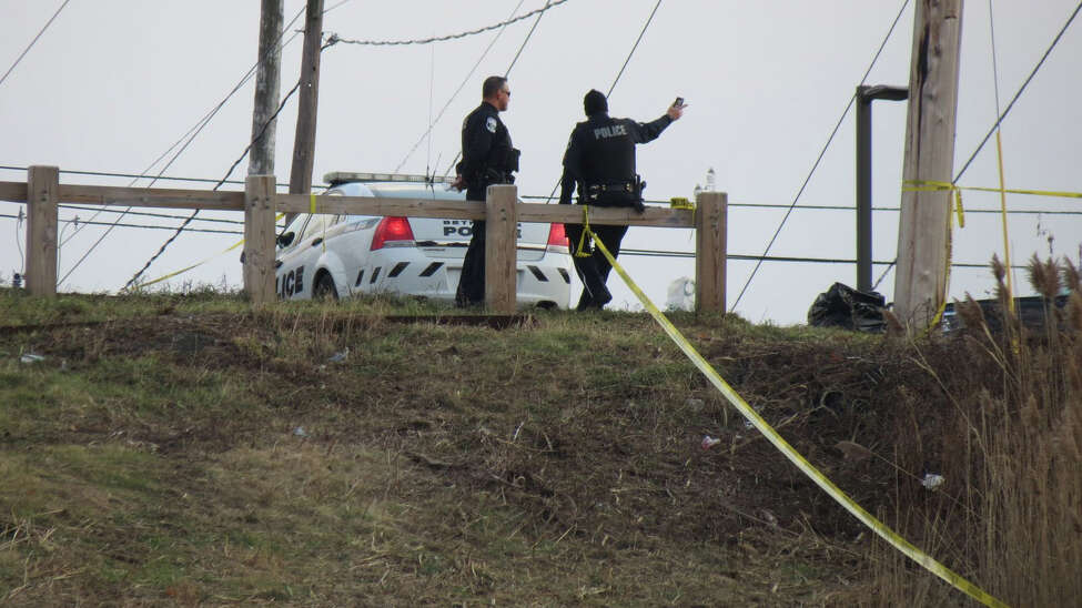Bethlehem police investigate the discovery of a decomposed body in a ravine behind Hoffman Car Wash in Delmar on Sunday Dec. 3, 2017. Police said a hunter walking through the area came across the remains at about 4:20 p.m. Saturday. The remains were found about midway between the top of the hill and Normans Kill.