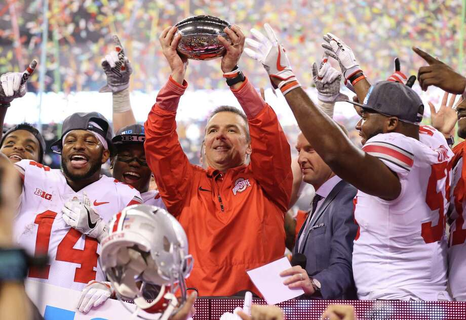 Ohio State coach Urban Meyer, center, and the Buckeyes were left holding the Big Ten trophy after winning the league title and not making the CFP field Sunday. Photo: Andy Lyons, Staff / 2017 Getty Images