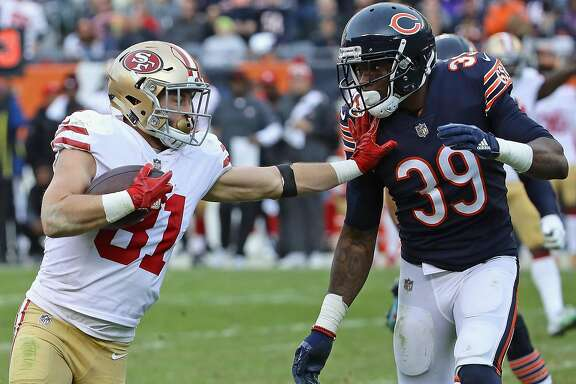 CHICAGO, IL - DECEMBER 03:  Trent Taylor #81 of the San Francisco 49ers tries to hold off Eddie Jackson #39 of the Chicago Bears on a 39 yard first down run after a catch at Soldier Field on December 3, 2017 in Chicago, Illinois. The 49ers defeated the Bears 15-14. (Photo by Jonathan Daniel/Getty Images)