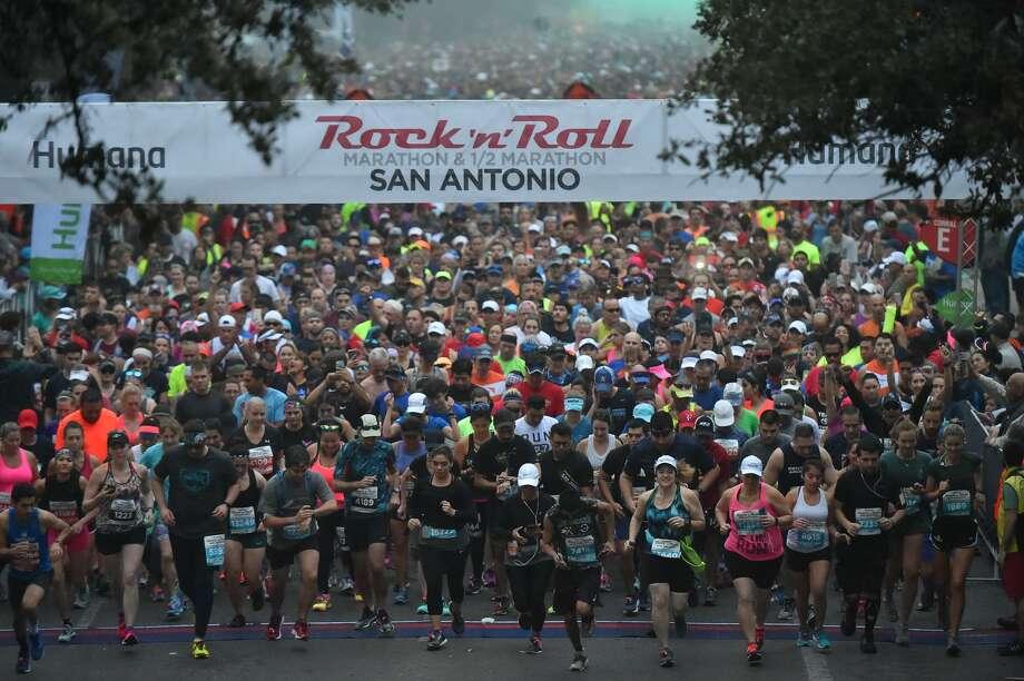 Thousands of runners head through the fog down Market St. at the start of Sunday's Rock N Roll Marathon. / ROBERT JERSTAD